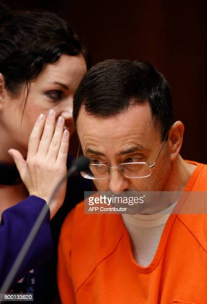 Former Michigan State University and USA Gymnastics doctor Larry Nassar with defense attorneys Shannon Smith at the 55th District Court where Judge...