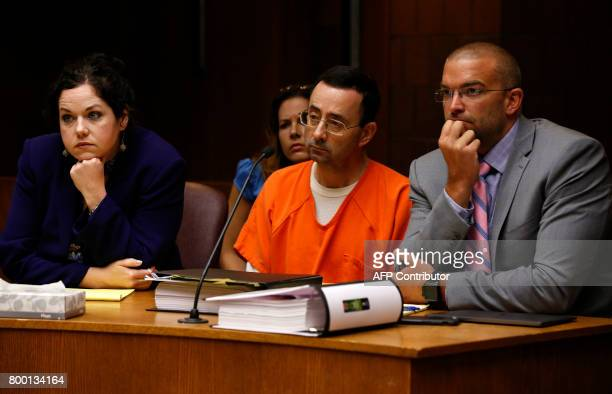Former Michigan State University and USA Gymnastics doctor Larry Nassar with defense attorneys Shannon Smith and Matt Newberg in the 55th District...