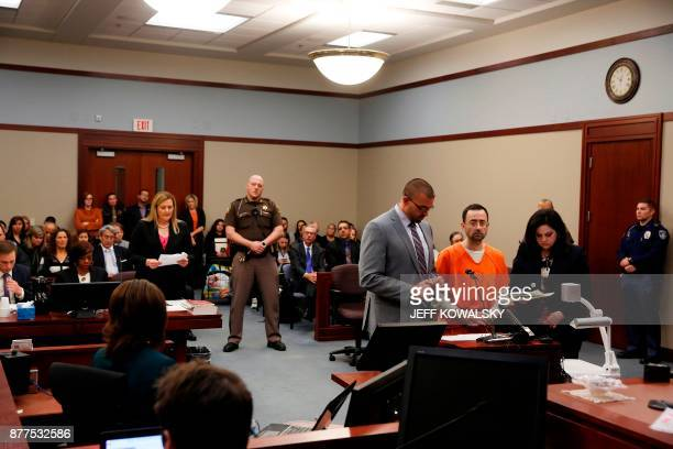Former Michigan State University and USA Gymnastics doctor Larry Nassar addresses the court with his defense attorneys Matt Newberg and Shannon Smith...