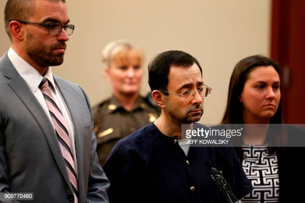 Former Michigan State University and USA Gymnastics doctor Larry Nassar with defense attorneys Matt Newberg and Molly Blythe during the sentencing...