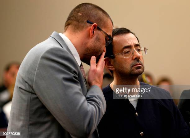 Former Michigan State University and USA Gymnastics doctor Larry Nassar stands with defense attorney Matt Newberg during the sentencing phase in...