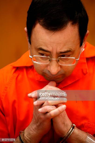Former Michigan State University and USA Gymnastics doctor Larry Nassar sits during the sentencing phase in Eaton County Circuit Court on January 31...