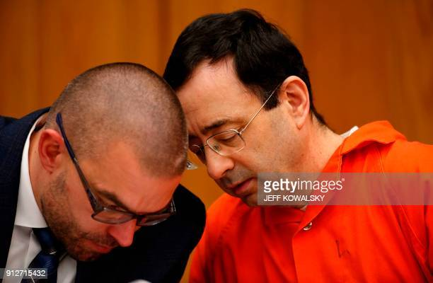 Former Michigan State University and USA Gymnastics doctor Larry Nassar with his defense attorney Matt Newberg during the sentencing phase in Eaton...