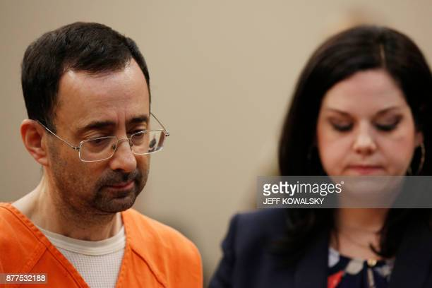 Former Michigan State University and USA Gymnastics doctor Larry Nassar listens to defense attorney Shannon Smith in Ingham County Circuit Court on...