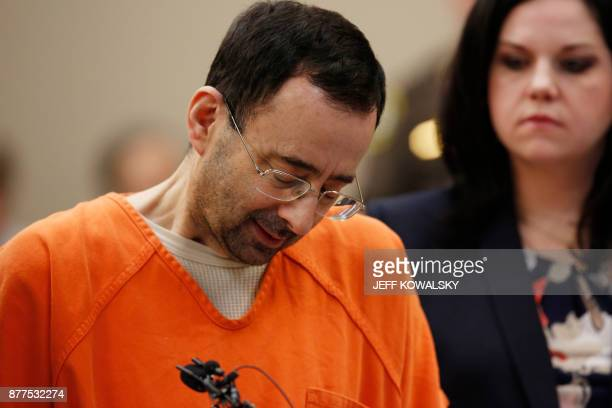 Former Michigan State University and USA Gymnastics doctor Larry Nassar reacts to defense attorney Shannon Smith reading the charges he pled to in...