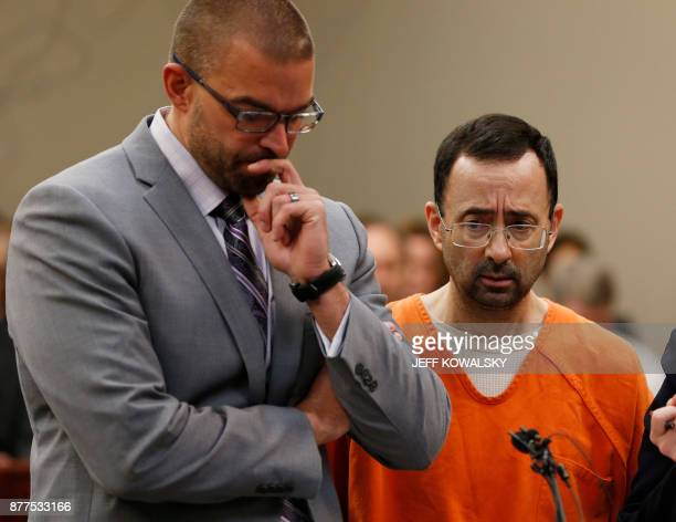 Former Michigan State University and USA Gymnastics doctor Larry Nassar listens to the court with his defense attorney Matt Newberg in Ingham County...