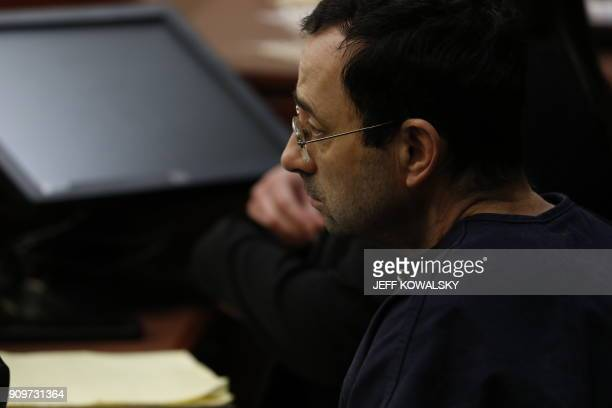 Former Michigan State University and USA Gymnastics doctor Larry Nassar arrives to give an impact statement during the sentencing phase in Ingham...