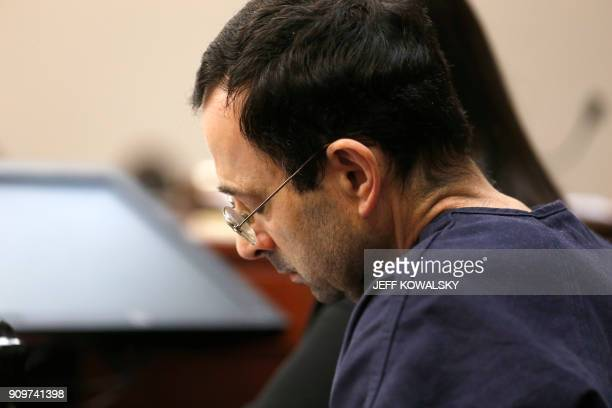 Former Michigan State University and USA Gymnastics doctor Larry Nassar listens to impact statements during the sentencing phase in Ingham County...