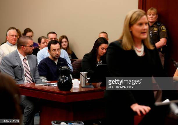 Former Michigan State University and USA Gymnastics doctor Larry Nassar listens to Asst Michigan Attorney General Angela M Povilaitis during the...