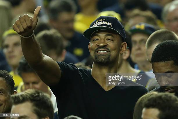 Former Michigan Wolverines player Juwan Howard supports Michigan against the Louisville Cardinals during the 2013 NCAA Men's Final Four Championship...