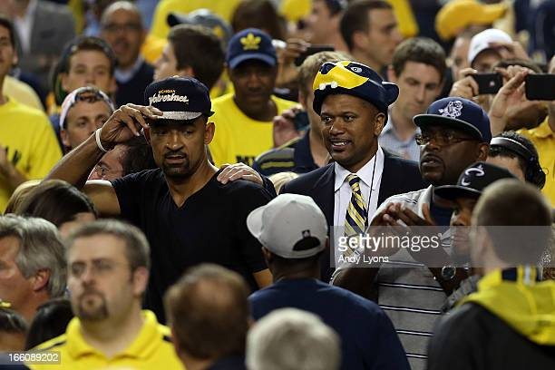 Former Michigan Wolverines players Juwan Howard and Jalen Rose greet MIchigan fans as the watch the Wolverines play against the Louisville Cardinals...