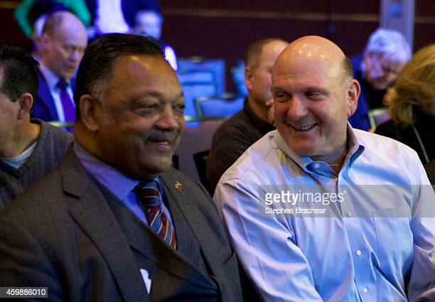 Former Microsoft CEO Steve Ballmer right and Reverend Jesse Jackson share a laugh before the Microsoft Shareholders Meeting December 3 2014 in...