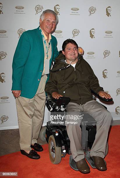 Former middle linebacker Nick Buoniconti of the Miami Dolphins and his son Marc Buoniconti attend the Miami Dolphins game at Landshark Stadium on...