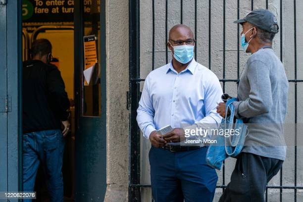 Former middle school principal Jamaal Bowman greets people outside a subway station on June 17 2020 in the Bronx borough of New York City Bowman is...