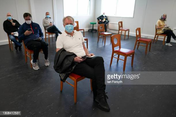 Former Middlesbrough Football Club player, Gary Pallister, waits in the post vaccine observation area after he receives his AstraZeneca/Oxford...