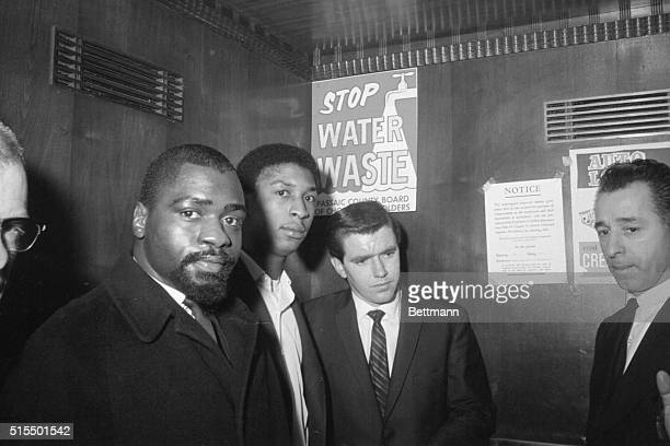 Former middleweight boxer Rubin 'Hurricane' Carter and John Artis are shown during their arraignment Dec 16 at the county courthouse here on charges...