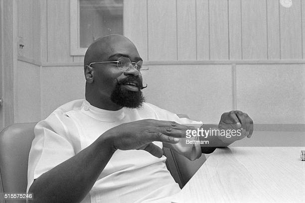 Former middleweight boxer Rubin Hurricane Carter gestures while speaking from prison where he serves time for a triple murder conviction Rahway State...