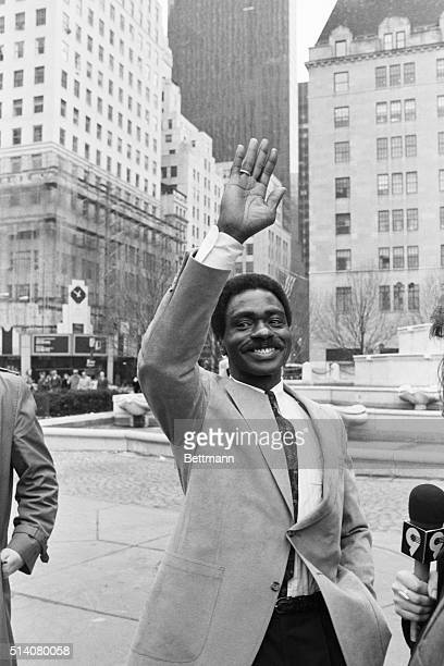 Former middleweight boxing contender Rubin Hurricane Carter waves and celebrates on the street after receiving his release from the New Jersey prison...