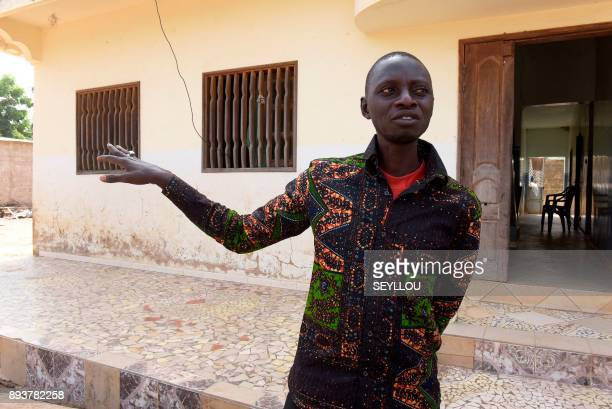 Former migrant worker in Italy municipal councilor of Nganda and head of a rice producers' association Pape Samba Diane speaks at his home in Nganda...