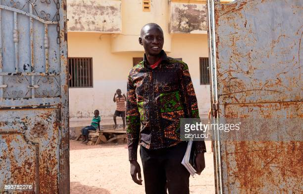Former migrant worker in Italy municipal councilor of Nganda and head of a rice producers' association Pape Samba Diane stands outside his home in...