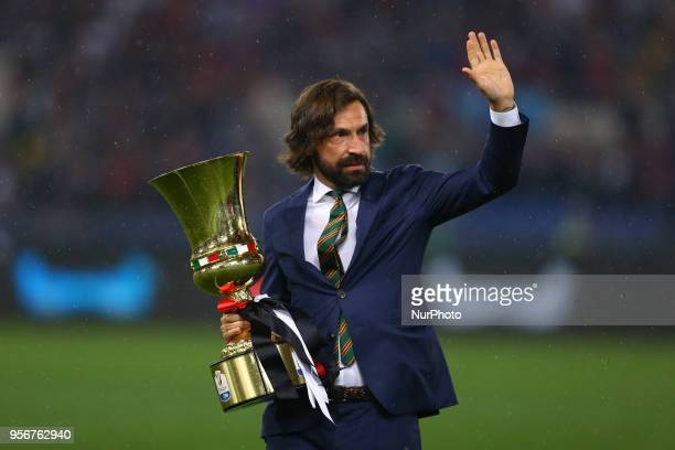 Former Milan and Juventus player Andrea Pirlo greeting the supporters with the cup on the field at Olimpico Stadium in Rome Italy on May 9 2017...