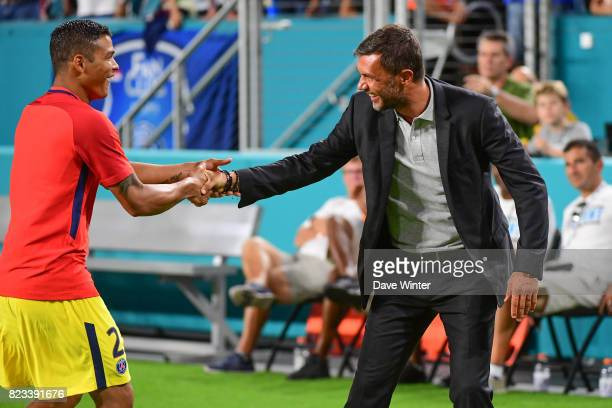 Former Milan player Paolo Maldini now coowner of North American Soccer League club Miami FC greets former Milan player Thiago Silva of PSG before the...