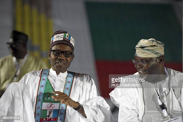 Former military ruler and presidential aspirant of the opposition All Progressives Congress Muhammadu Buhari reacts as he discusses with closest...