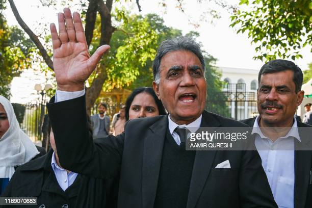 Former military ruler Pervez Musharraf's lawyer Akhtar Shah speaks to the members of the media after a verdict outside a special court in Islamabad...