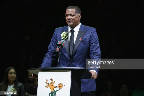 Former Milwaukee Bucks player Marques Johnson speaks during a ceremony during the game between the Cleveland Cavaliers and Milwaukee Bucks at the...