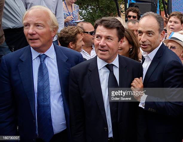 Former minister Brice Hortefeux Christian Estrosi and General secretary of UMP party Jean Francois Cope arrives at second day of the first Rally of...
