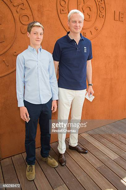 Former minister Bruno Le Maire and his son attend the Roland Garros French Tennis Open 2014 Day 15 at Roland Garros on June 8 2014 in Paris France