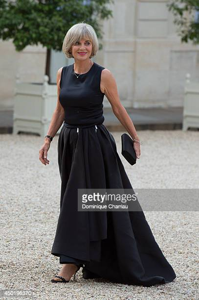 Former minister Elisabeth Guigou arrives at the Elysee Palace for a State dinner in honor of Queen Elizabeth II hosted by French President Francois...