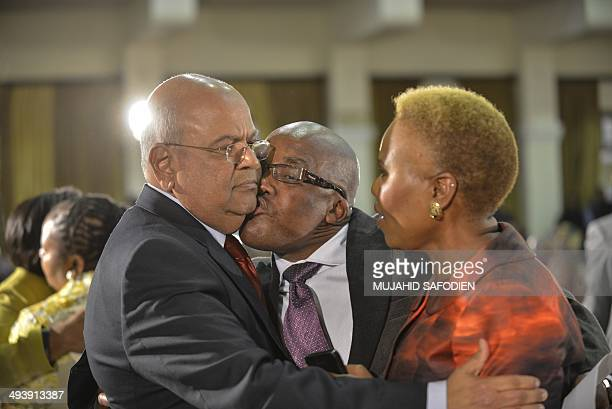 Former Minister of Finance Pravin Gordhan , Minister of Health Aaron Motsoaledi and South African government official Lindiwe Zulu share a moment...