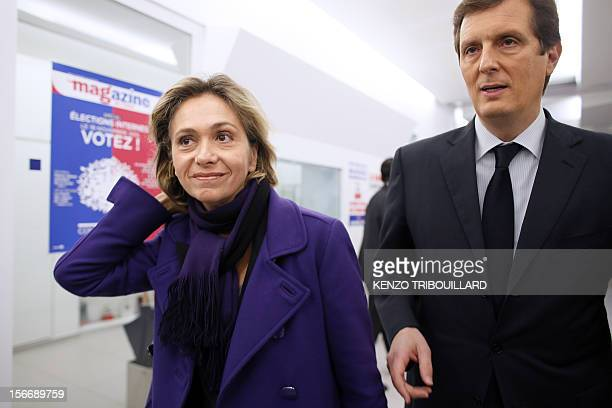 Former minister Valerie Pecresse and UMP's PM Jerome Chartier are pictured upon their arrival at the UMP party at the party's headquarters on...