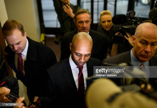 Former Minneapolis Police officer Mohamed Noor arrives with his lawyers Thomas Plunkett and Peter Wold for the beginning of his trial on April 1 2019...