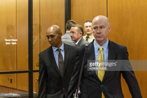 Former Minneapolis Police officer Mohamed Noor arrives with his attorneys Thomas Plunkett and Peter Wold for the beginning of his trial in...