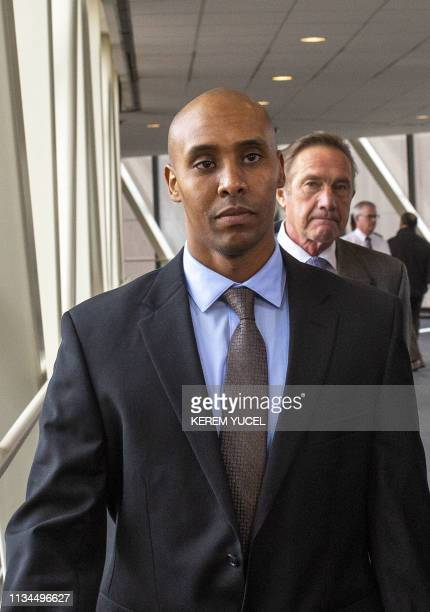 Former Minneapolis police officer Mohamed Noor flanked by attorneys Peter Wold and Thomas Plunkett leaves the Hennepin County Government Center in...