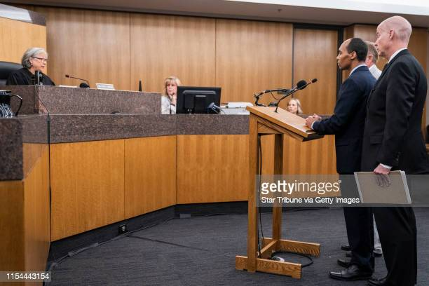 Former Minneapolis police officer Mohamed Noor standing with his lawyers Thomas Plunkett closest to camera and Peter Wold behind Noor is sentenced by...