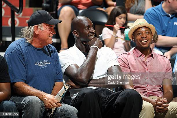Former Minnesota Governor Jesse Ventura Kevin Garnett of the Boston Celtics and former Timberwolves player Troy Hudson enjoy the game between the...