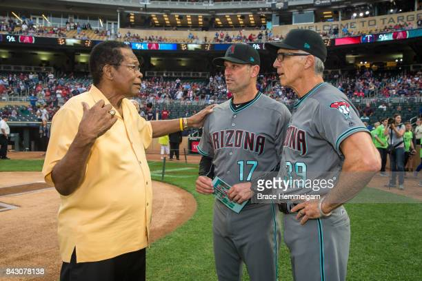 Former Minnesota Twins and hall of fame player Rod Carew talks with manager Torey Lovullo of the Arizona Diamondbacks and Dave McKay prior to the...