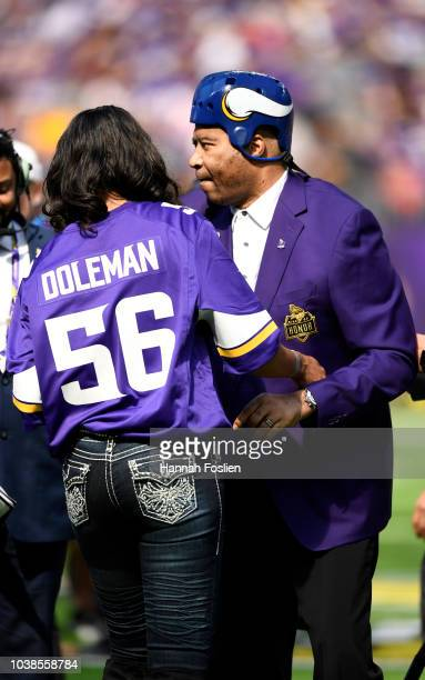 Former Minnesota Vikings defensive end Chris Doleman is helped off the field after the Vikings Ring of Honor induction ceremony for the late coach...