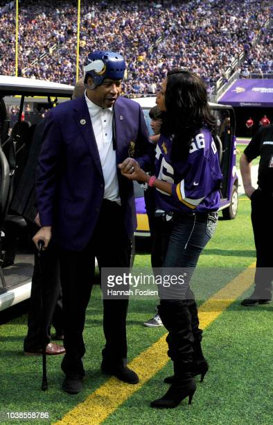 Former Minnesota Vikings defensive end Chris Doleman is helped on the field before the Vikings Ring of Honor induction ceremony for the late coach...