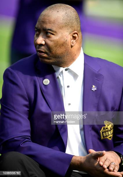 Former Minnesota Vikings defensive end Chris Doleman sits on field during the Vikings Ring of Honor induction ceremony for the late coach Dennis...