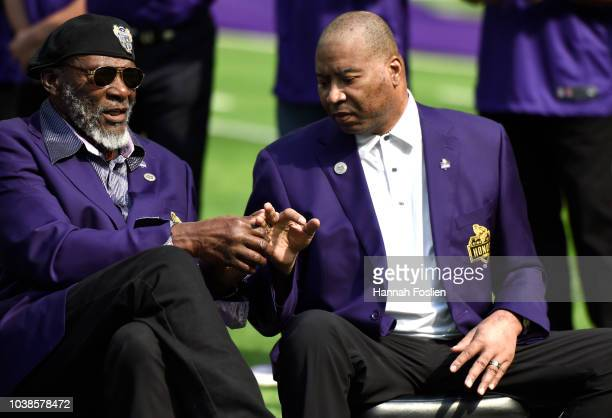 Former Minnesota Vikings players Carl Eller and Chris Doleman sit on field during the Vikings Ring of Honor induction ceremony for the late coach...