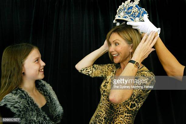 Former Miss Australia 1973 Michelle Downes with daughter Jemima Taylor playing around with the Miss Australia pageant crown before a ceremony at the...