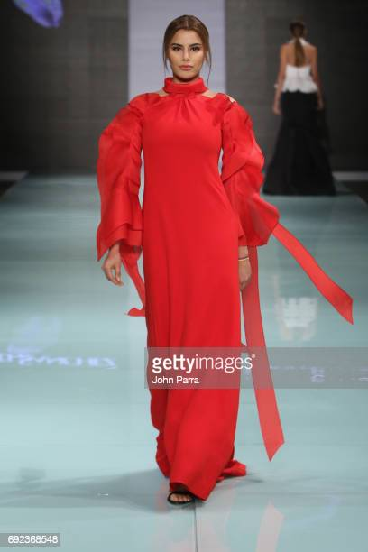 Former Miss Colombia Ariadna Gutierres walks the runway at the Angel Sanchez Fashion Show at Miami Fashion Week at Ice Palace Film Studios on June 4...