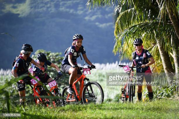 Former Miss France 2014 Flora Coquerel from the Brazza Gang team competes in the mountain bike race during the Raid des Alizes an exclusively...