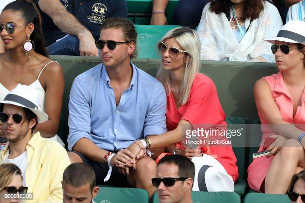 Former Miss france Alexandra Rosenfeld and her boyfriend Tom Lamb attend the 2018 French Open Day Eight at Roland Garros on June 3 2018 in Paris...