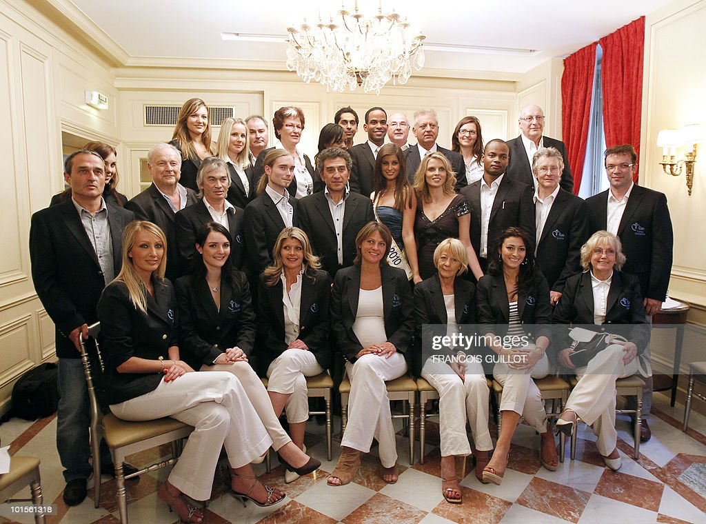 Former Miss France and Miss France society new president Sylvie Tellier (second R, 4th R) and Miss France 2010 Malika Menard (second R, 5th R) pose with the president of regional Miss France committees after a press conference to present next Miss France 2011 pageant on June 2, 2010 in Paris. The election is schedule next december in Caen, Normandy.