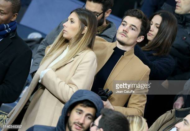 Former Miss France Camille Cerf and her boyfriend Cyrille attend the French Cup semi-final between Paris Saint-Germain and FC Nantes at Parc des...